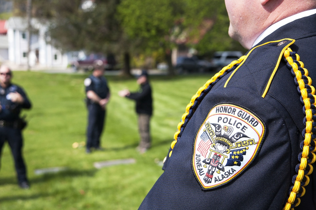 Juneau Police Detective Jeff Brink waits for a memorial ceremony to begin Wednesday, May 10, 207, at Evergreen Cemetery, Juneau. (Photo by Tripp J Crouse/KTOO)